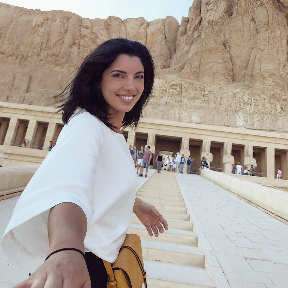 a girl is climbing the stairs to enter Hatchepsut temple in Luxor