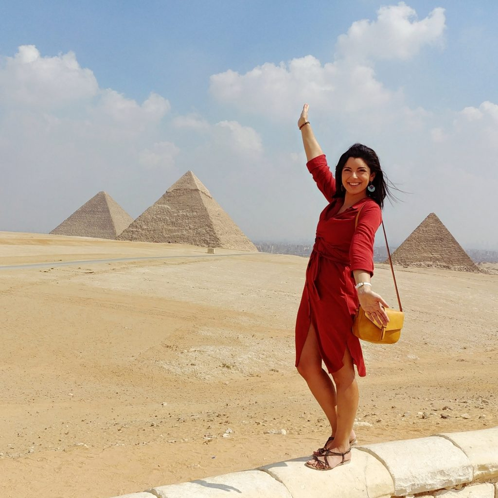 girl with pyramids of Cairo