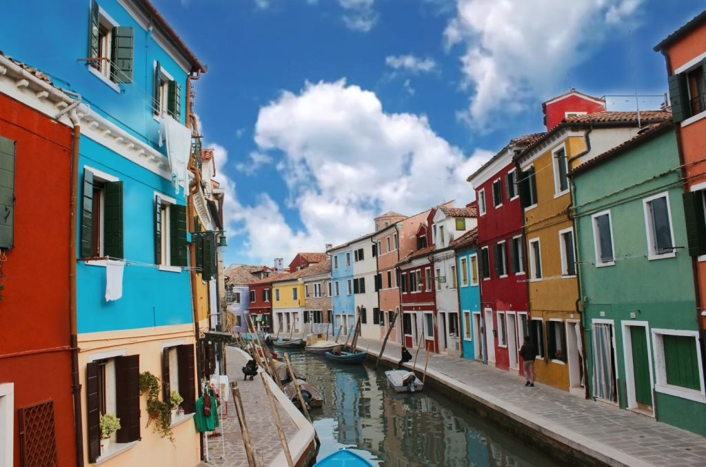 small canal surrounded by colorful houses in Burano island