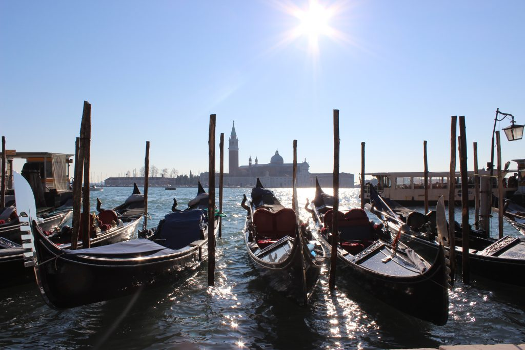 beautiful gondolas on the river bank of Venice