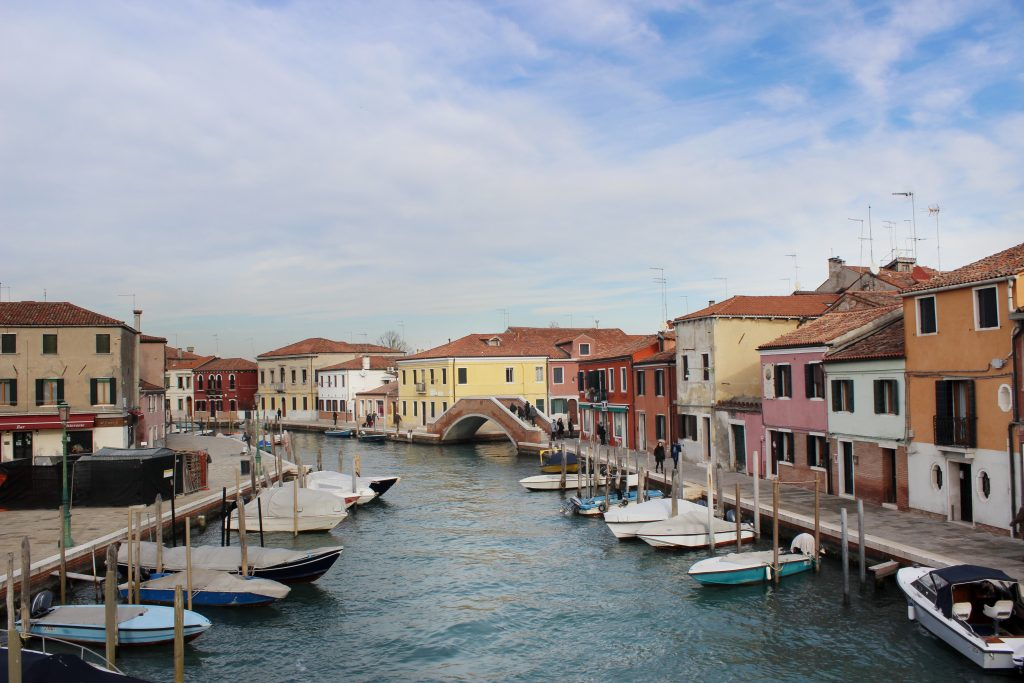 a canal view with colorful houses in Murano Island - Venice