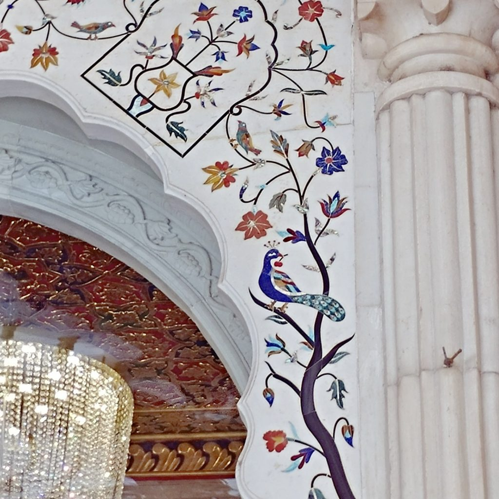 the main building has so many wall decoration with white marble and precious stones