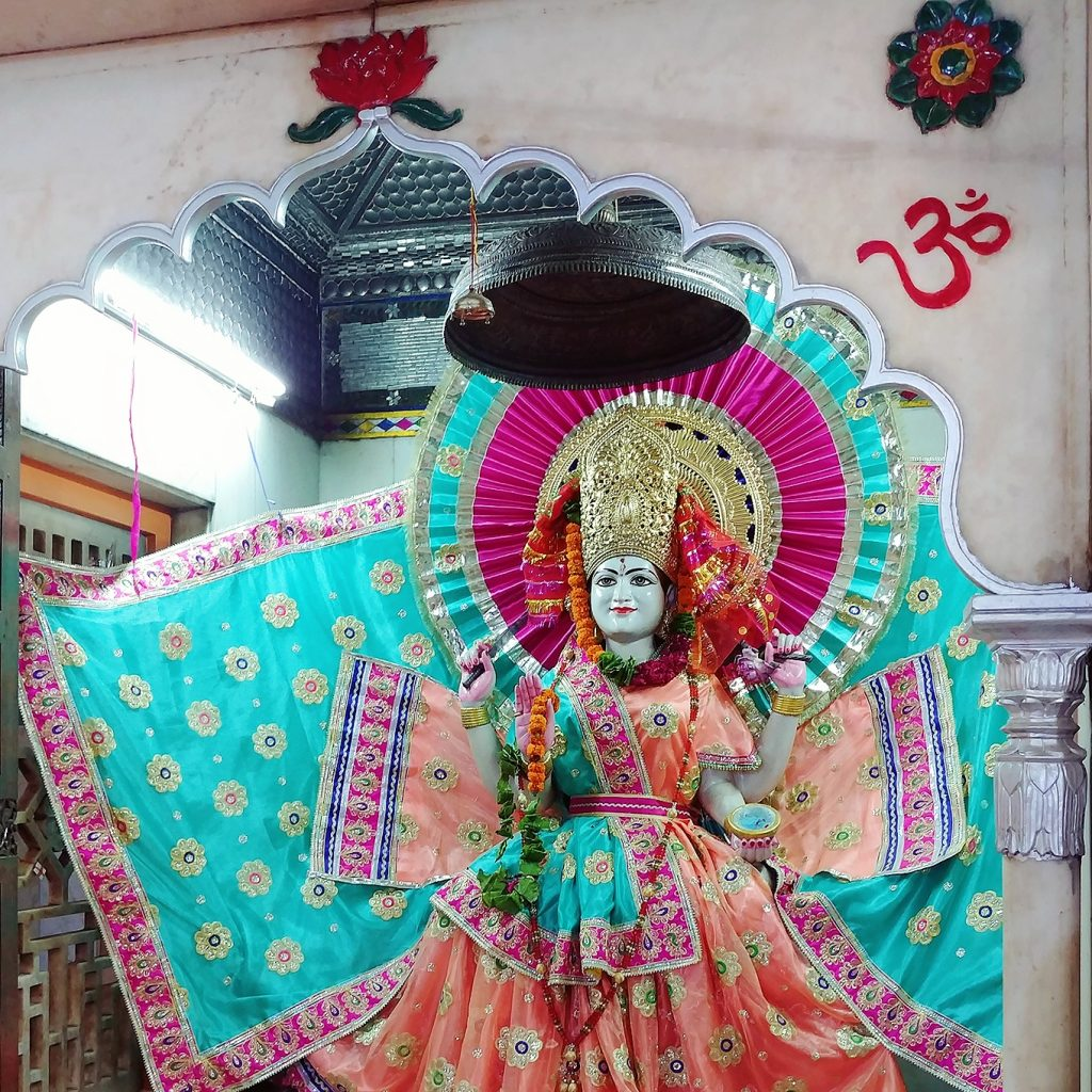 one of the god representation is wearing colorful attires inside the temple