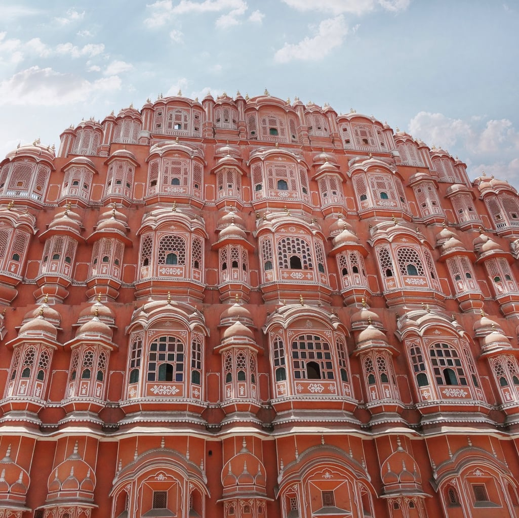 one of the best place to see in Jaipur - view from the street of the pink sandstone Palace of the Winds