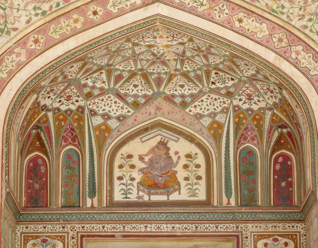 sumptuous painting details with Ganeesh in the center