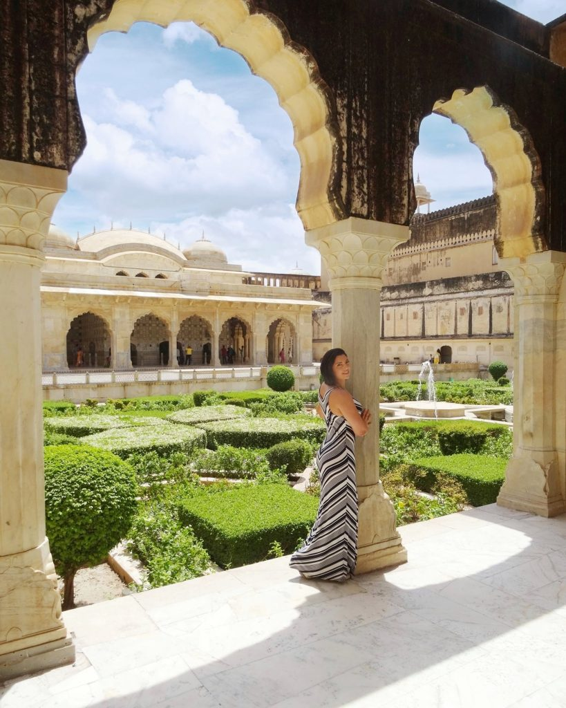one of the best place to see in Jaipur - interior courtyard with sculpted garden inside Amber Fort