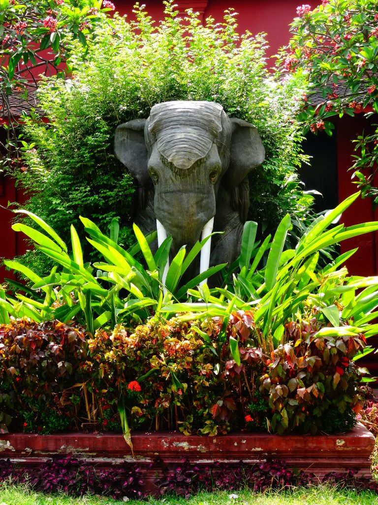 an elephant statue at the entrance of the museum