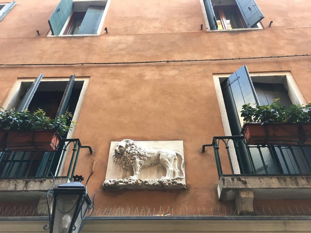 lion of St. Mark sculpture on house wall
