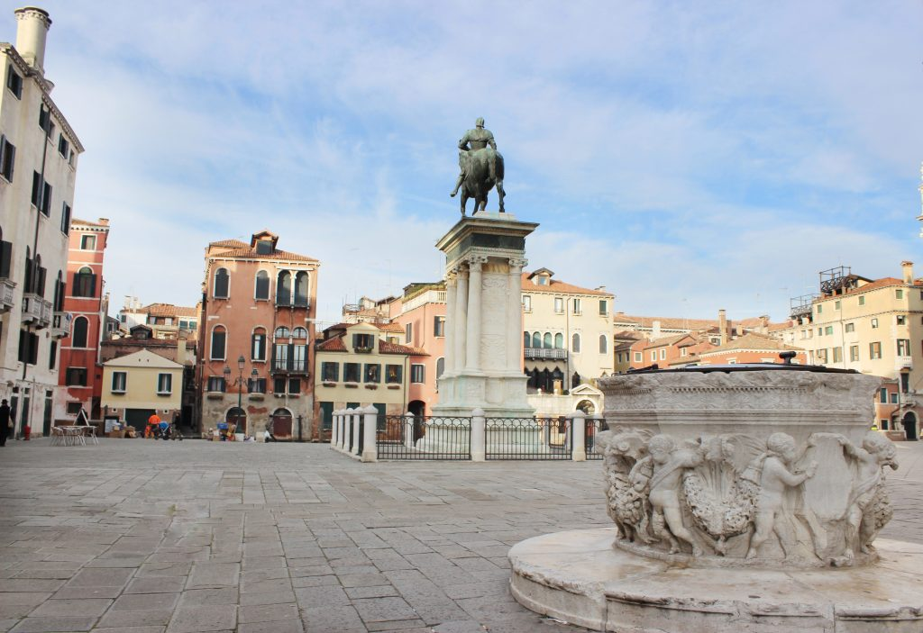 wide place with fountain and sculpture of man with horse in Venice