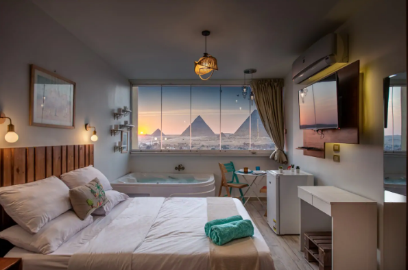 a room in Cairo with beautiful view of the Pyramids of Giza