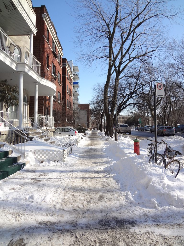 a street with snow in Montreal