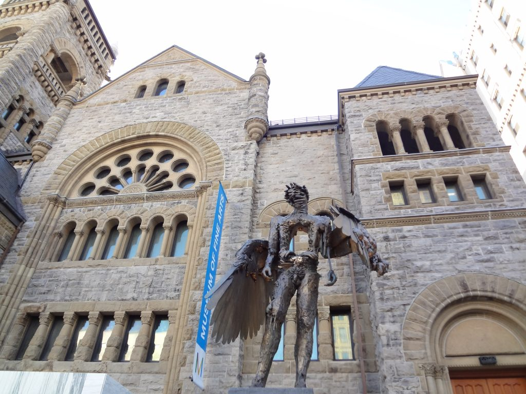 building facade with angel statue