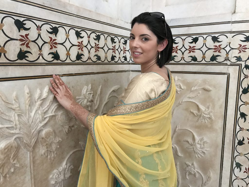 a girl is admiring the interior architecture of Taj Mahal