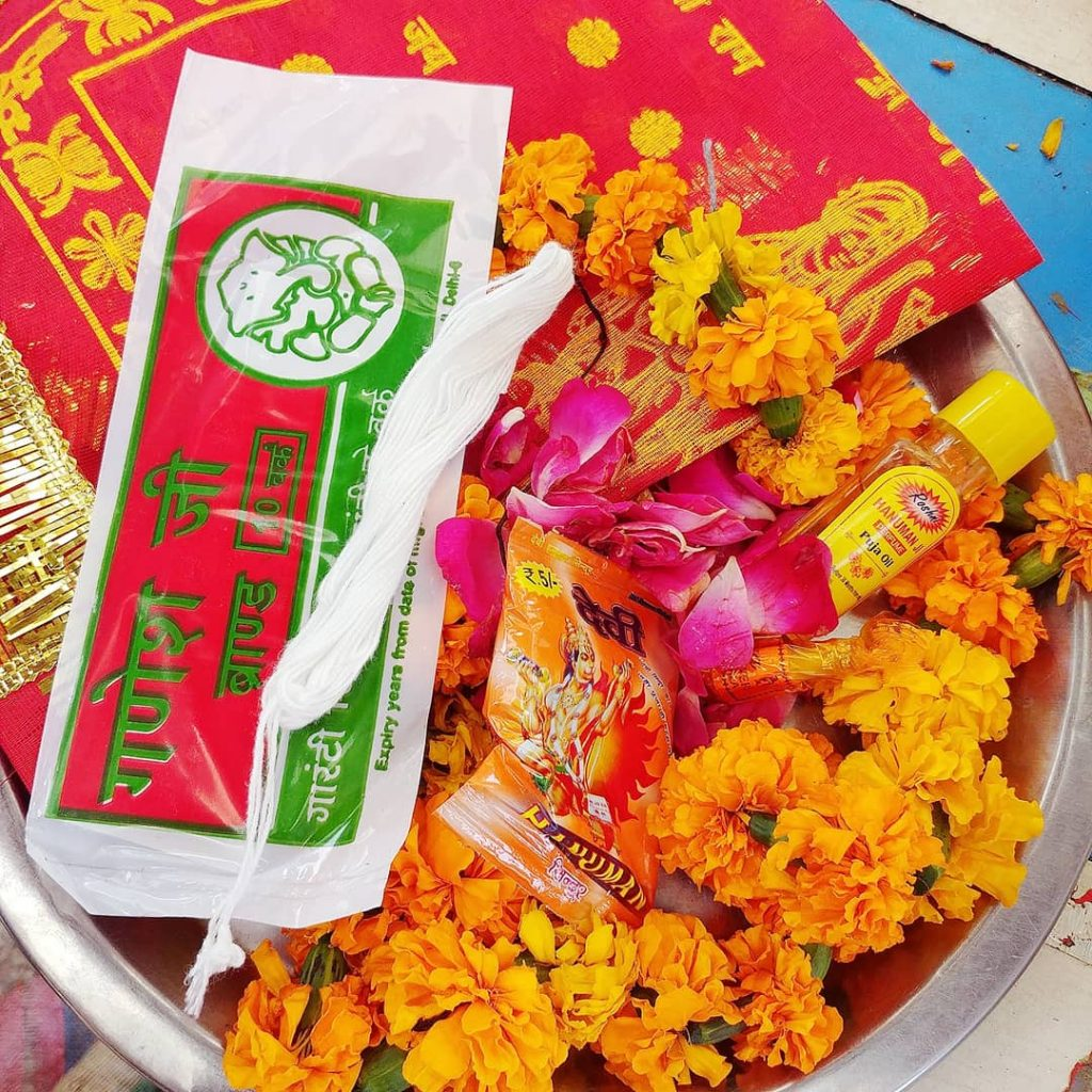 a bowl of flowers and perfums to offer to gods inside the temple