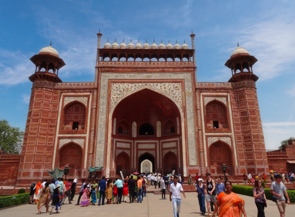 the crowd is rushing to the main gate to enter the Taj Mahal site