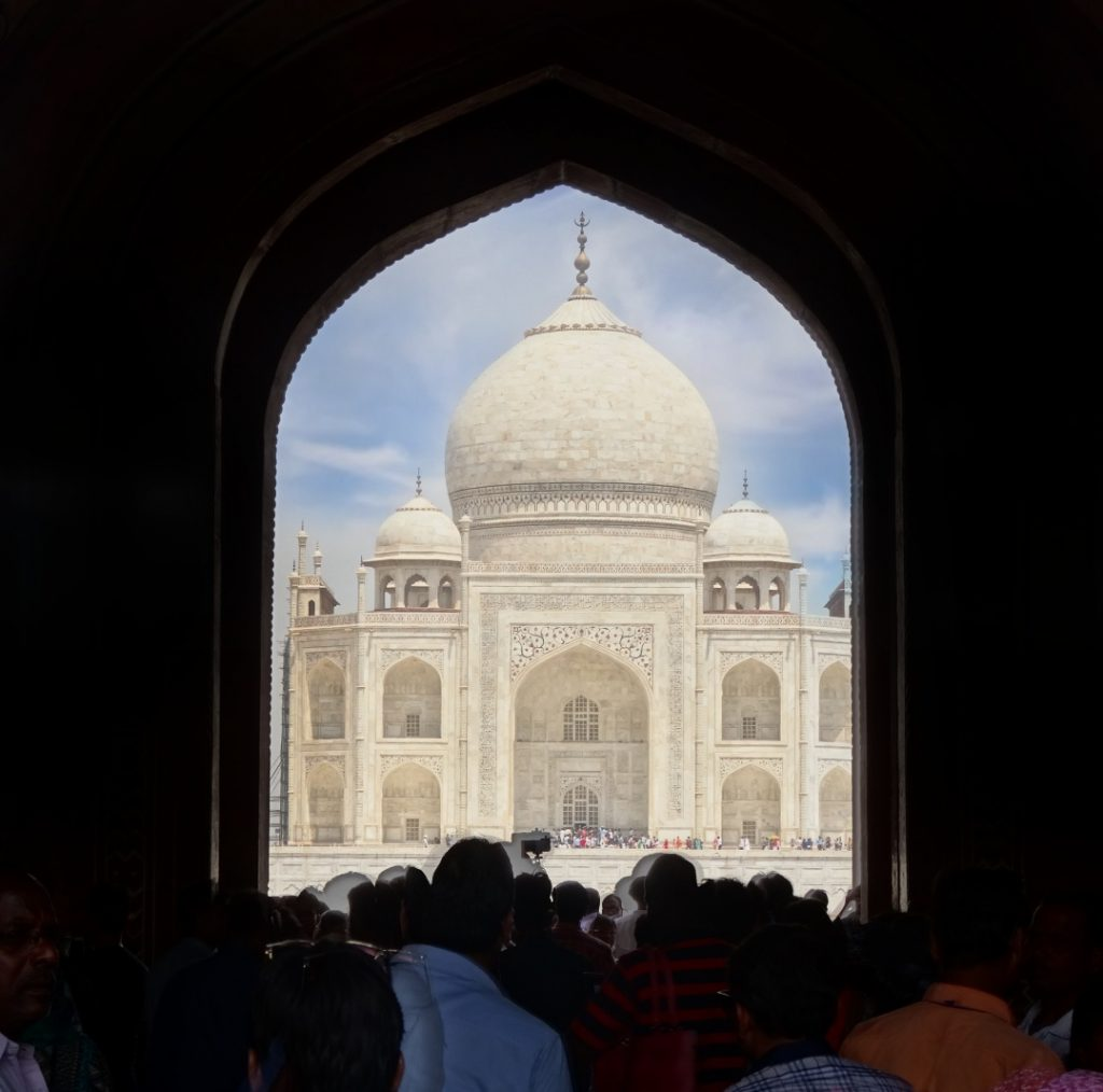 the crowd is rushing to see the Taj Mahal