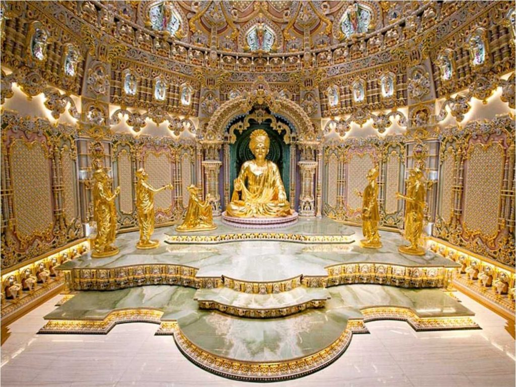 the main dome unveils a big golden statue of deiti sitting on green marble