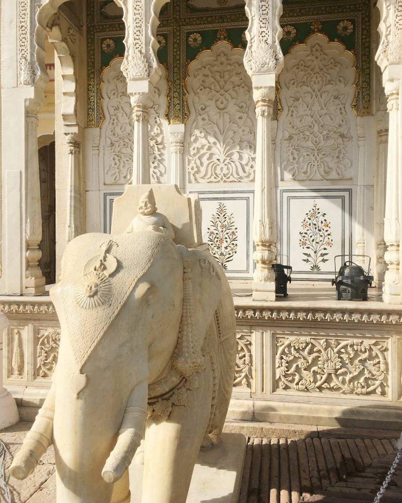 marble details with an elephant and a Maharaja statue inside the City Palace of Jaipur