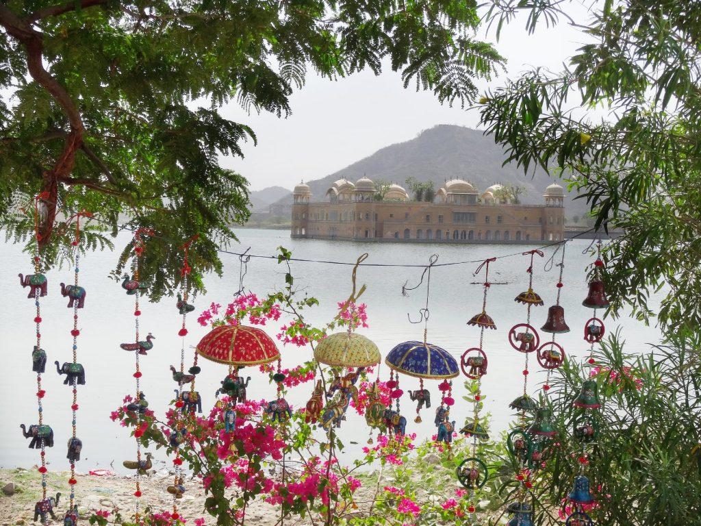 one of thebest place to see in Jaipur - the beautiful water palace Jal Mahal and some handicrafts souvenirs hanging from the trees