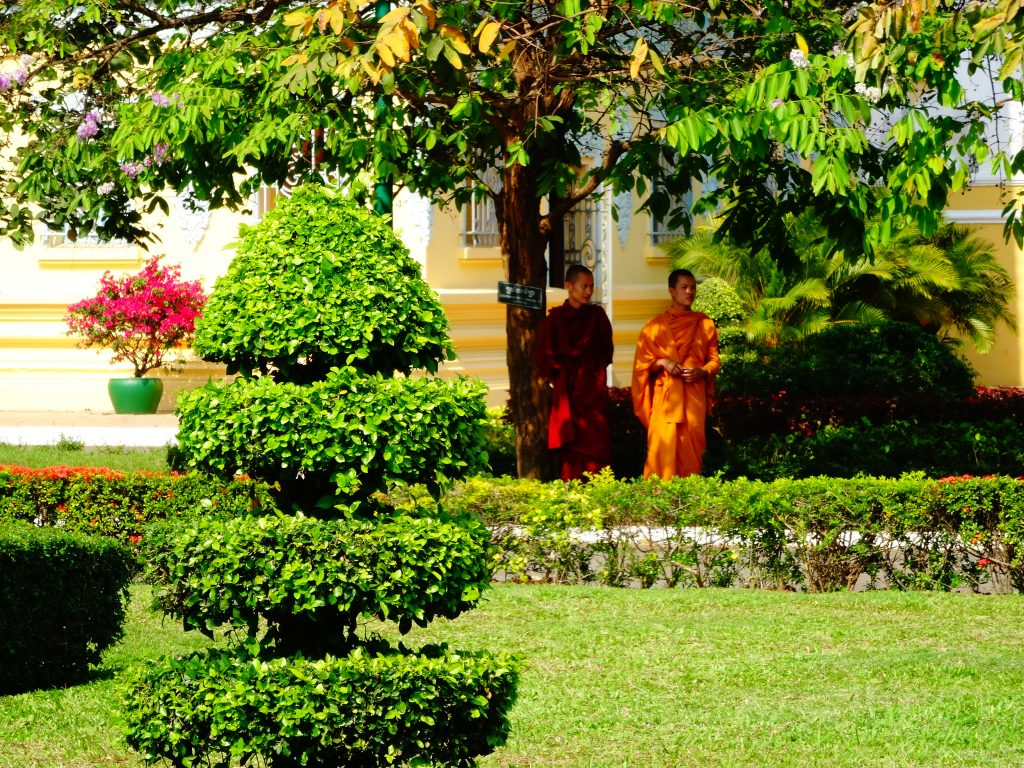 two monks walkign into the gardens of the royal palace