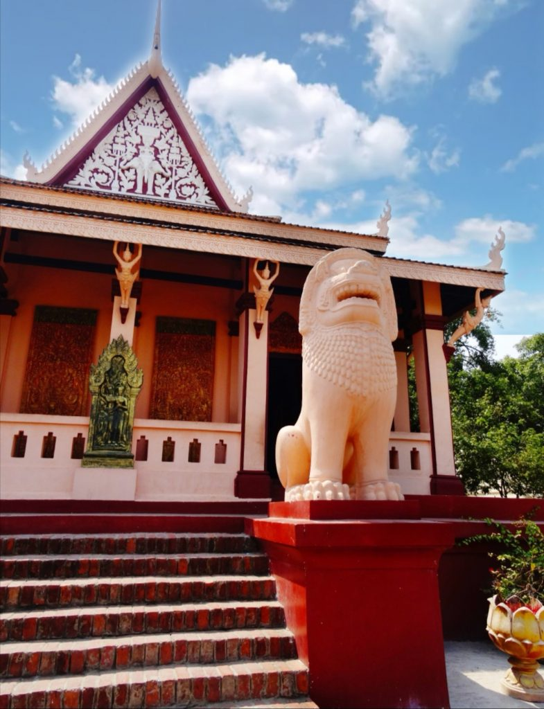a lion statue protects the pagoda